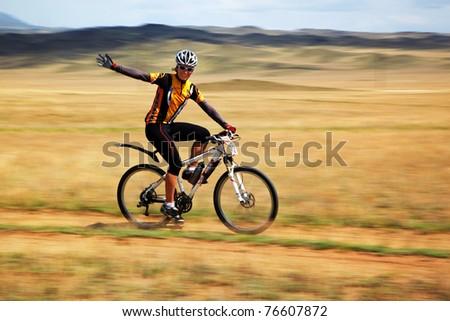"ALMATY, KAZAKHSTAN - APRIL 30: G.Balagurova (N28) in action at Adventure mountain bike cross-country marathon in mountains ""Jeyran Trophy 2011"" April 30, 2011 in Almaty, Kazakhstan. - stock photo"