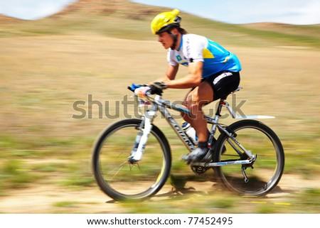 """ALMATY, KAZAKHSTAN - APRIL 30: K.Kazantcev (N7) in action at Adventure mountain bike cross-country marathon in mountains """"Jeyran Trophy 2011"""" April 30, 2011 in Almaty, Kazakhstan. - stock photo"""