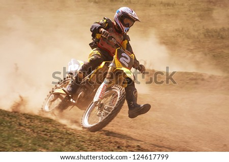 """ALMATY, KAZAKHSTAN - APRIL 22 N.Orel (N2) at the Motocross competition """"Fabrichny Cup""""- Open Championship of Kazakhstan on April 22, 2012 in Almaty, Kazakhstan. - stock photo"""