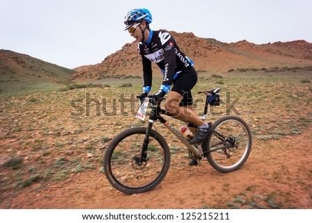 "ALMATY, KAZAKHSTAN - APRIL 29: N.Tlegenov (N6)  in action at Adventure mountain bike cross-country marathon in mountains ""Jeyran Trophy 2012"" April 29, 2012 in Almaty, Kazakhstan. - stock photo"