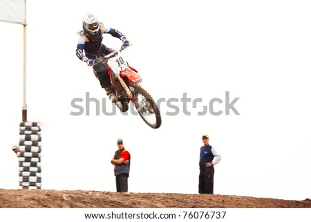 """ALMATY, KAZAKHSTAN - APRIL 17: P.Blinov(10) in action at  Motocross competition """"Fabrichny Cup""""- Open Championship of Kazakhstan, on April 17, 2011 in Kargaly, Kazakhstan. - stock photo"""