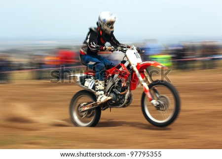 """ALMATY, KAZAKHSTAN - APRIL 10: P.Blinov(10) in action at Motocross competition """"Fabrichny Cup""""- Open Championship of Kazakhstan, on April 10, 2011 in Kargaly, Kazakhstan. - stock photo"""
