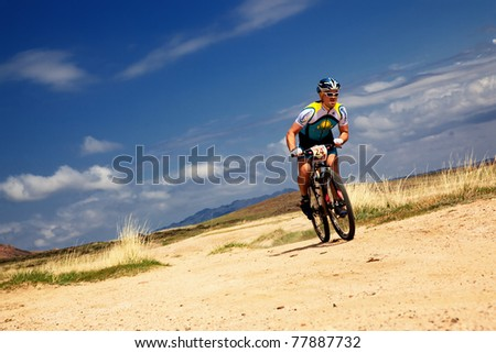 "ALMATY, KAZAKHSTAN - APRIL 30: R.Nurjanov (N24) in action at Adventure mountain bike cross-country marathon in mountains ""Jeyran Trophy 2011"" April 30, 2011 in Almaty, Kazakhstan. - stock photo"