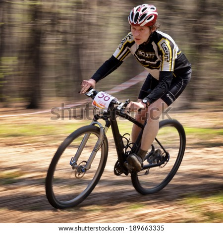 "ALMATY, KAZAKHSTAN - APRIL 19, 2014: S.Kachanov (N56) in action at cross-country competition ""Open season - Bikes relay 2014""  - stock photo"