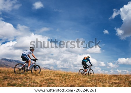 "ALMATY, KAZAKHSTAN - APRIL 30: T.Amirbekov (left) in action at Adventure mountain bike cross-country marathon in mountains ""Jeyran Trophy 2012"" April 30, 2012 in Almaty, Kazakhstan. - stock photo"