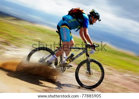 "ALMATY, KAZAKHSTAN - APRIL 30: T.Dauranov (N25) in action at Adventure mountain bike cross-country marathon in mountains ""Jeyran Trophy 2011"" April 30, 2011 in Almaty, Kazakhstan. - stock photo"