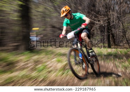 "ALMATY, KAZAKHSTAN - APRIL 19, 2014: Unknown rider in action at cross-country competition ""Open season - Bikes relay 2014""  - stock photo"