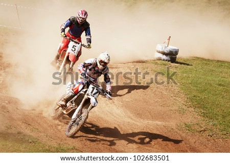 """ALMATY, KAZAKHSTAN - APRIL 22 Unknown riders at the Motocross competition """"Fabrichny Cup""""- Open Championship of Kazakhstan on April 22, 2012 in Almaty, Kazakhstan. - stock photo"""