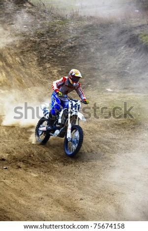 """ALMATY, KAZAKHSTAN - APRIL 10: V.Drozd(141) at  Motocross competition """"Fabrichny Cup""""- Open Championship of Kazakhstan, on April 10, 2011 in Kargaly, Kazakhstan. - stock photo"""