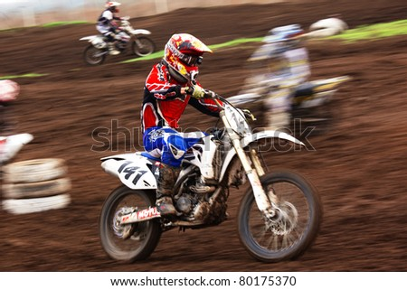"""ALMATY, KAZAKHSTAN - APRIL 17: V.Drozd(141) at Motocross competition """"Fabrichny Cup""""- Open Championship of Kazakhstan, on April 17, 2011 in Kargaly, Kazakhstan. - stock photo"""