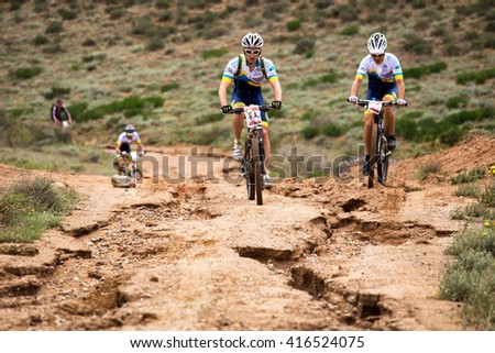 "ALMATY, KAZAKHSTAN - APRIL 30, 2016: V.Ganja (N11) in action at Adventure mountain bike cross-country competition in mountains ""Jeyran Trophy 2016""  - stock photo"