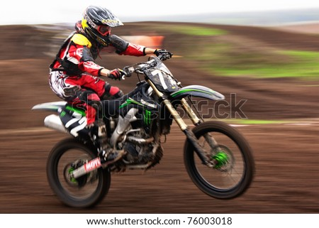 """ALMATY, KAZAKHSTAN - APRIL 17: V.Marchenko(72) in action at  Motocross competition """"Fabrichny Cup""""- Open Championship of Kazakhstan, on April 17, 2011 in Kargaly, Kazakhstan. - stock photo"""