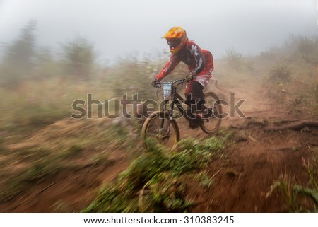 ALMATY, KAZAKHSTAN - AUGUST 22, 2015: D.Masalsky (N32) in action at Mountain Bike sports event DOWNHILL EXTREME WEEKEND.  - stock photo