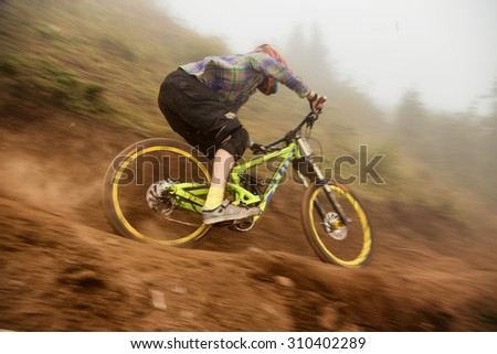 ALMATY, KAZAKHSTAN - AUGUST 22, 2015: Unknown rider in action at Mountain Bike sports event DOWNHILL EXTREME WEEKEND.