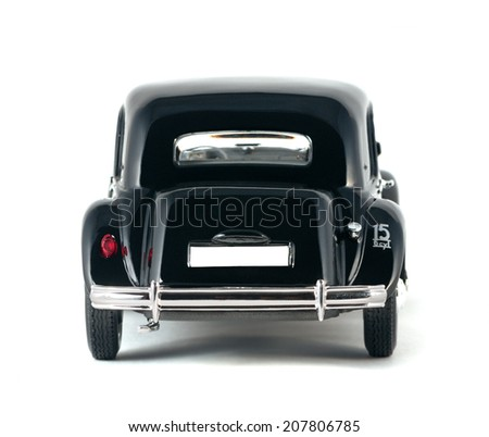 ALMATY, KAZAKHSTAN - FEBRUARY 23, 2014: Black Vintage collectible model cars Citroen 15 CV Cyl isolated on white background back view.