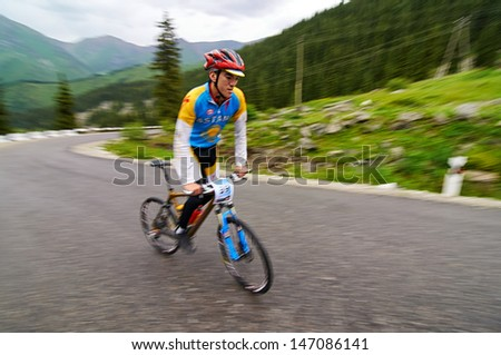 "ALMATY, KAZAKHSTAN - JULY 14: J.Bakhytbekuly (No. 39) in action at  the sports event Up Hill ""Ayu Say Cup"" 2013 on July 14, 2013 in Almaty, Kazakhstan."