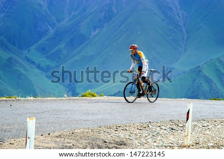 """ALMATY, KAZAKHSTAN - JULY 14: J.Bakhytbekuly (No. 39) in action at  the sports event Up Hill """"Ayu Say Cup"""" 2013 on July 14, 2013 in Almaty, Kazakhstan. - stock photo"""