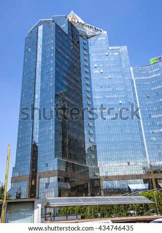 ALMATY, KAZAKHSTAN - JUNE 8, 2016: Business Center Nurly Tau in Almaty, Kazakhstan. Made in the style of Hi-Tech, repeating silhouettes of mountains Zailisky Alatau. Construction company - Basis A.