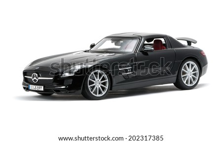 ALMATY, KAZAKHSTAN - june 22, 2014 - Collectible toy Mercedes-Benz SLS Sedan isolated on white background front view - stock photo