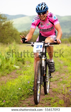 "ALMATY, KAZAKHSTAN - JUNE 20: I.Popov (N21) in action at Adventure mountain bike cross-country competition ""Ak Bulak 2010"" June 20, 2010 in Almaty, Kazakhstan - stock photo"