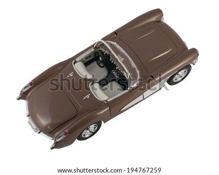 Almaty, Kazakhstan - March 6, 2014: Collectible toy car convertible Chevrolet Corvette 1957 on a white background - stock photo