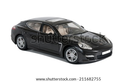 Almaty, Kazakhstan - 10 March 2014: Collectible toy car Porsche Panamera Turbo side view on a white background - stock photo