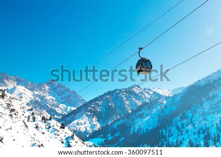 Almaty, Kazakhstan - March, 2, 2014:  Ski lift, Gondola lift, cable car at Medeo to Shymbulak route near Almaty against mountain background