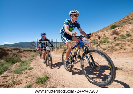 "ALMATY, KAZAKHSTAN - MAY 05, 2013: A.Buyanauskas (N13) in action at Adventure mountain bike cross-country competition in mountains ""Jeyran Trophy 2013""  - stock photo"