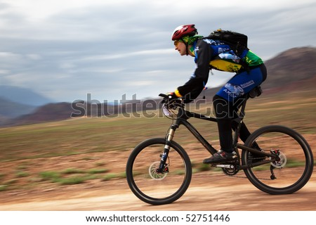 "ALMATY, KAZAKHSTAN - MAY 1: A.Shvedov in action at Adventure mountain bike cross-country marathon in mountains ""Jeyran Trophy 2010"" May 1, 2010 in Almaty, Kazakhstan. - stock photo"