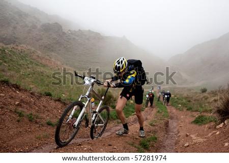 "ALMATY, KAZAKHSTAN - MAY 2:D.Rahimkulov (N32) in action at Adventure mountain bike cross-country marathon in mountains ""Jeyran Trophy 2010"" May 2, 2010 in Almaty, Kazakhstan. - stock photo"