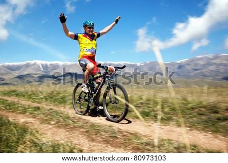 "ALMATY, KAZAKHSTAN - MAY 01: E.Kazantcev (N10) in action at Adventure mountain bike cross-country marathon in mountains ""Jeyran Trophy 2011"" May 1, 2011 in Almaty, Kazakhstan. - stock photo"