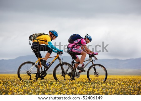 "ALMATY, KAZAKHSTAN - MAY 2: I.Popov and M.Dzolba (left) in action at Adventure mountain bike cross-country marathon in mountains ""Jeyran Trophy 2010"" May 2, 2010 in Almaty, Kazakhstan. - stock photo"