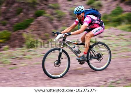 "ALMATY, KAZAKHSTAN - MAY 01: I.Popov (N3) in action at Adventure mountain bike cross-country marathon in mountains ""Jeyran Trophy 2012"" May 01, 2012 in Almaty, Kazakhstan. - stock photo"