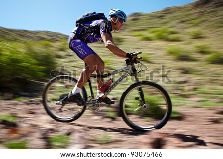 "ALMATY, KAZAKHSTAN - MAY 2: I.Popov (N5) in action at Adventure mountain bike cross-country marathon in mountains ""Jeyran Trophy 2011"" on May 2, 2011 in Almaty, Kazakhstan. - stock photo"