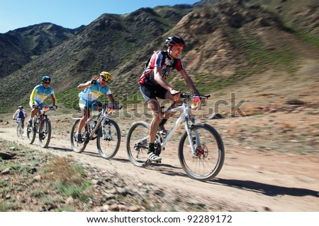 "ALMATY, KAZAKHSTAN - MAY 2: K.Kazantcev (N7) and other in action at Adventure mountain bike cross-country marathon in mountains ""Jeyran Trophy 2011"" May 2, 2011 in Almaty, Kazakhstan. - stock photo"