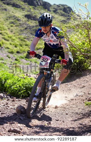 "ALMATY, KAZAKHSTAN - MAY 2: M.Budko (N30) in action at Adventure mountain bike cross-country marathon in mountains ""Jeyran Trophy 2011"" on May 2, 2011 in Almaty, Kazakhstan. - stock photo"