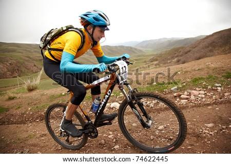"ALMATY, KAZAKHSTAN - MAY 2: M.Dzolba (N12) in action at Adventure mountain bike cross-country marathon in mountains ""Jeyran Trophy 2010"" May 2, 2010 in Almaty, Kazakhstan. - stock photo"
