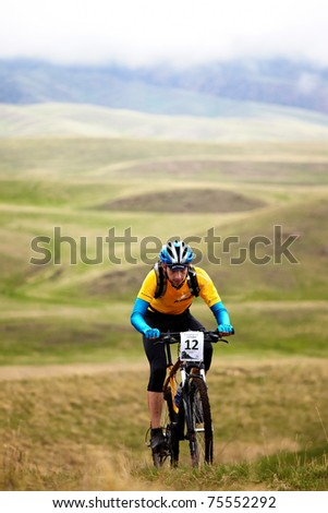 "ALMATY, KAZAKHSTAN - MAY 2: M.Dzolba (N12) in action at Adventure mountain bike cross-country marathon in mountains ""Jeyran Trophy 2010"" May 2, 2010 in Almaty, Kazakhstan. - stock photo"