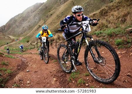 "ALMATY, KAZAKHSTAN - MAY 2: M.Kolbasov (N24) in action at Adventure mountain bike cross-country marathon in mountains ""Jeyran Trophy 2010"" May 2, 2010 in Almaty, Kazakhstan. - stock photo"