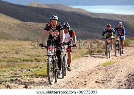 "ALMATY, KAZAKHSTAN - MAY 01: M.Kolbasov (N14) in action at Adventure mountain bike cross-country marathon in mountains ""Jeyran Trophy 2011"" May 1, 2011 in Almaty, Kazakhstan. - stock photo"