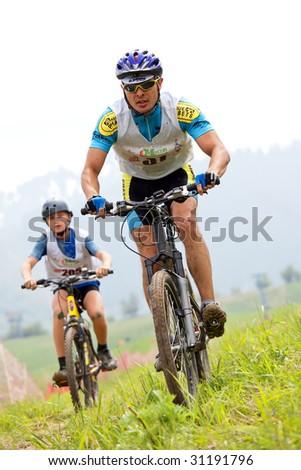 ALMATY, KAZAKHSTAN - May 23: Nurjan Tlegenov in action at cross-country mountain bike race Mercur Open Cup in Almaty , Kazakhstan May 23, 2009. - stock photo