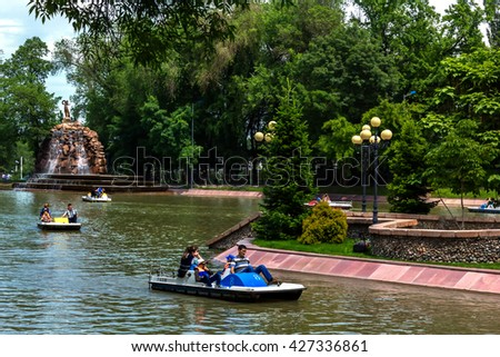 Almaty, Kazakhstan - May 22, 2016. People boating on the lake. Central City Park of the city of Almaty - one of the biggest in the city.