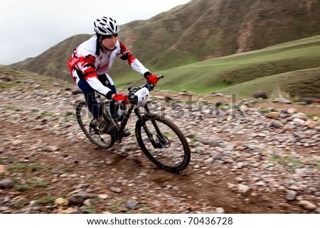 "ALMATY, KAZAKHSTAN - MAY 2: R.Fayzullin (N17) in action at Adventure mountain bike cross-country marathon in mountains ""Jeyran Trophy 2010"" May 2, 2010 in Almaty, Kazakhstan. - stock photo"