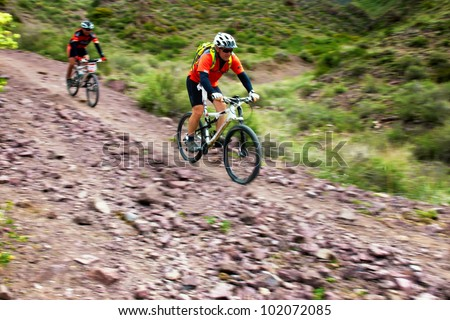"""ALMATY, KAZAKHSTAN - MAY 01: S.Yshkov (first) in action at Adventure mountain bike cross-country marathon in mountains """"Jeyran Trophy 2012"""" May 01, 2012 in Almaty, Kazakhstan. - stock photo"""