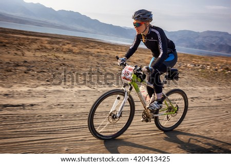"ALMATY, KAZAKHSTAN - MAY 01, 2016: T.Sherbanenko (N35) in action at Adventure mountain bike cross-country competition in mountains ""Jeyran Trophy 2016"""