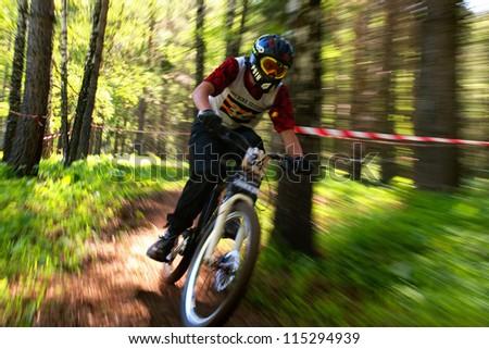 ALMATY, KAZAKHSTAN - MAY 27: Y.Konotopov (N34) in action at Freestyle Mountain Bike Session in Almaty, Kazakhstan MAY 27, 2012. - stock photo