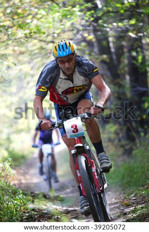 ALMATY, KAZAKHSTAN - OCTOBER 18: Andrey Ukhovin action at cross-country mountain bike 'Apple race' October 18, 2009 in Almaty, Kazakhstan. - stock photo