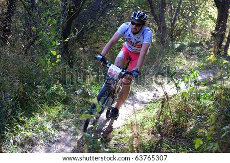 ALMATY, KAZAKHSTAN - OCTOBER 18: Arman Arynov(N22) in action at cross-country mountain bike 'Apple race' October 18, 2009 in Almaty , Kazakhstan. - stock photo