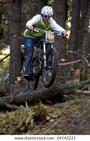 ALMATY, KAZAKHSTAN - OCTOBER 31: E.Galiev(N17) in action at downhill mountain bike 'Pumpkin Race on ART Track. Mini DH. Halloween' October 31, 2010 in Almaty , Kazakhstan.