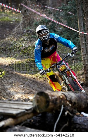 ALMATY, KAZAKHSTAN - OCTOBER 31: J.Kumakbaev(N36) in action at downhill mountain bike 'Pumpkin Race on ART Track. Mini DH. Halloween' October 31, 2010 in Almaty , Kazakhstan.